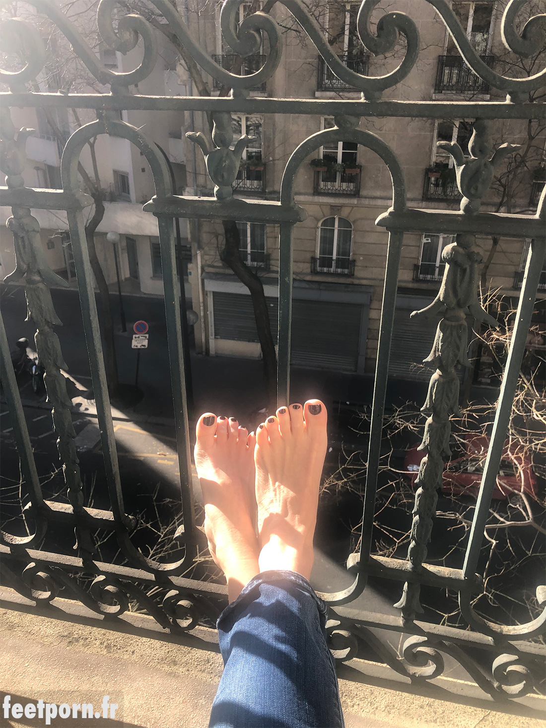 My girlfriend's feet on the balcony