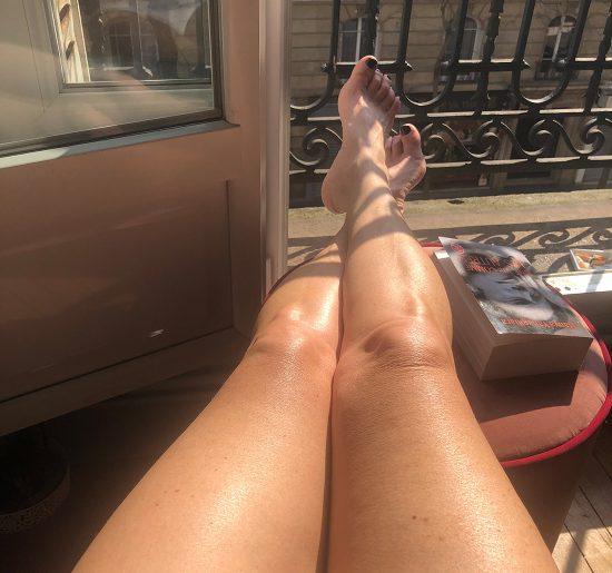 A hot mature slut sunbathing