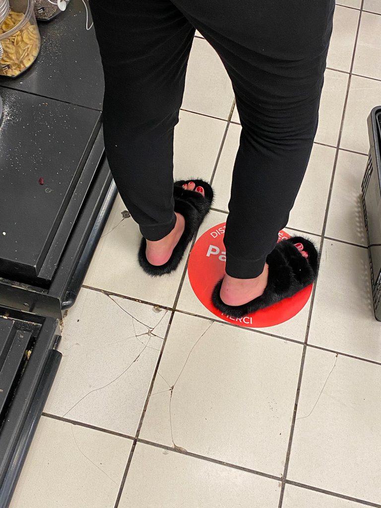 Vulgar girl with fur tap sandals