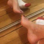 MILF girlfriend puts sports socks on