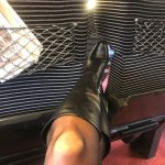 My wife with leather boots and pantyhose in a train