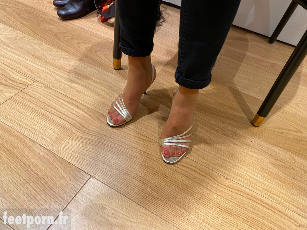 A MILF in pants with luxurious golden sandals