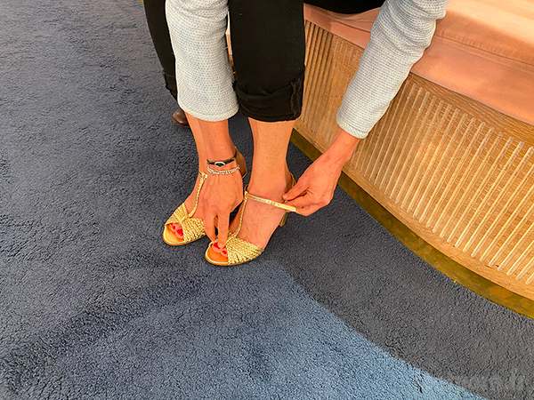 A MILF in pants with golden sandals
